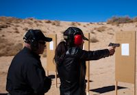 David Brown assisting a student on the firing range